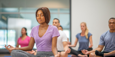 Woman meditating with group